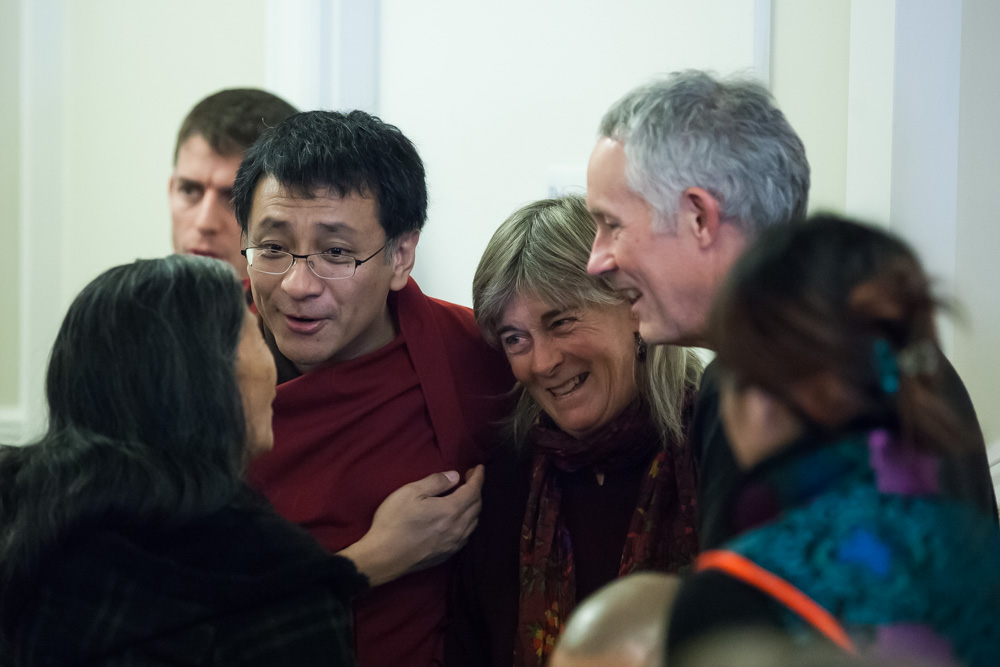 "Dzogchen Ponlop Rinpoche greets guests at ""Awake in Seattle"" at Nalanda West."